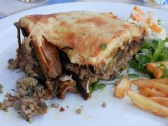 Greek Moussaka with aubergines and fries
