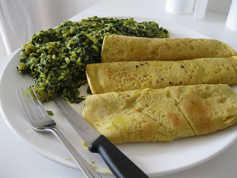 Vegan pancakes with spinach and rice