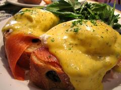 Eggs Benedict, an American breakfast dish made with poached eggs and hollandaise sauce