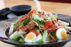Bacon with boiled eggs by salad dressing
